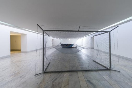 "Patera, 2015, Tube and metallic mesh, barbed wire, boat and clothes, 198 x 350 x 1400 cm (View of the work at ""Ignoto"" exhibition, CAS - Arts Center of Sines)"