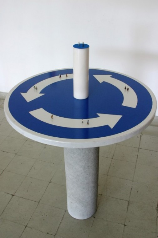 """This Way Only # 4"", 2009, Traffic sign, cement drain-pipe, marble, velvet paper and model figures, 113 x 74 x 74 cm"