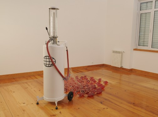 The Drain, 2007, Petrol pump, blood bags, oil and vinyl sticker, 180 x 100 x 200 cm